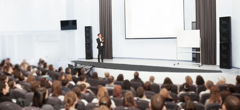 A presentation being held on a stage.