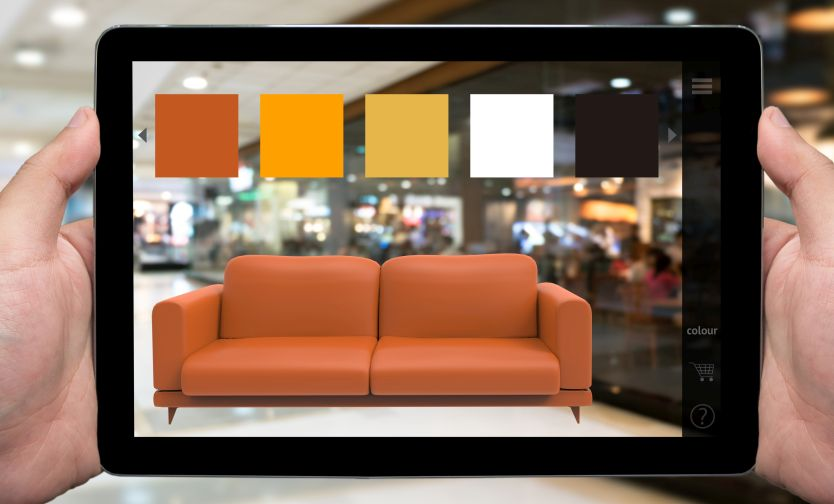 Using augmented reality to see how a couch looks in a room.