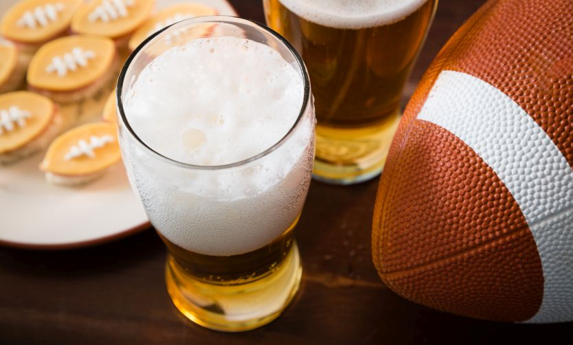 A football sitting next to some snacks.