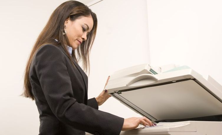 Business woman using a copier