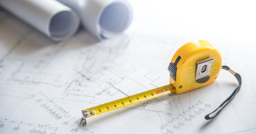 Tape measure on building plans