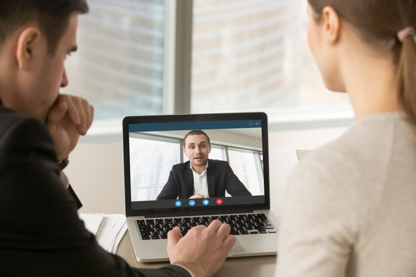 Business people video calling on a laptop
