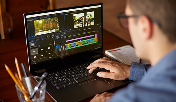 Laptop being used for video editing